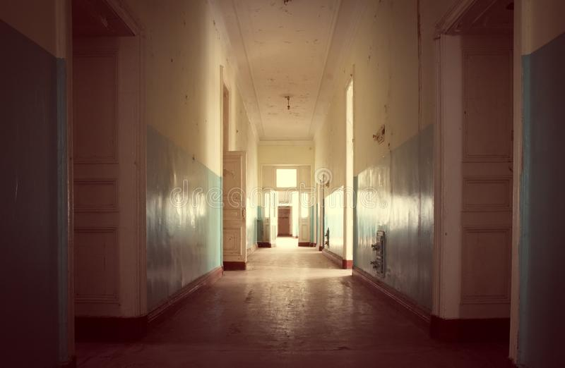 Abandoned long corridor and room in old house stock photo