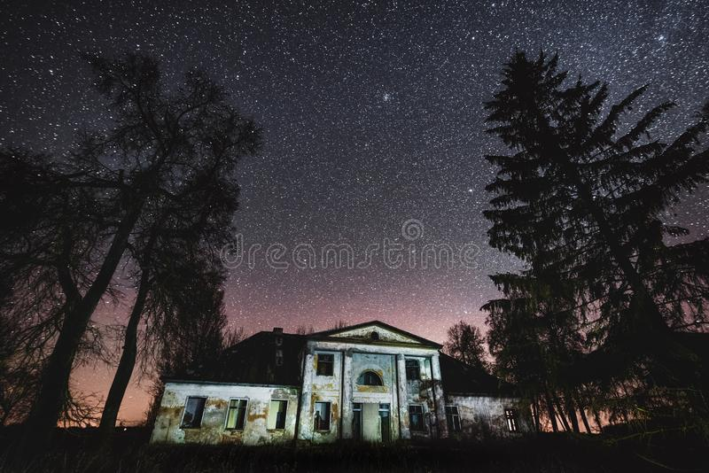 Abandoned manor house at night in Lithuania. Gulbinai manor royalty free stock images