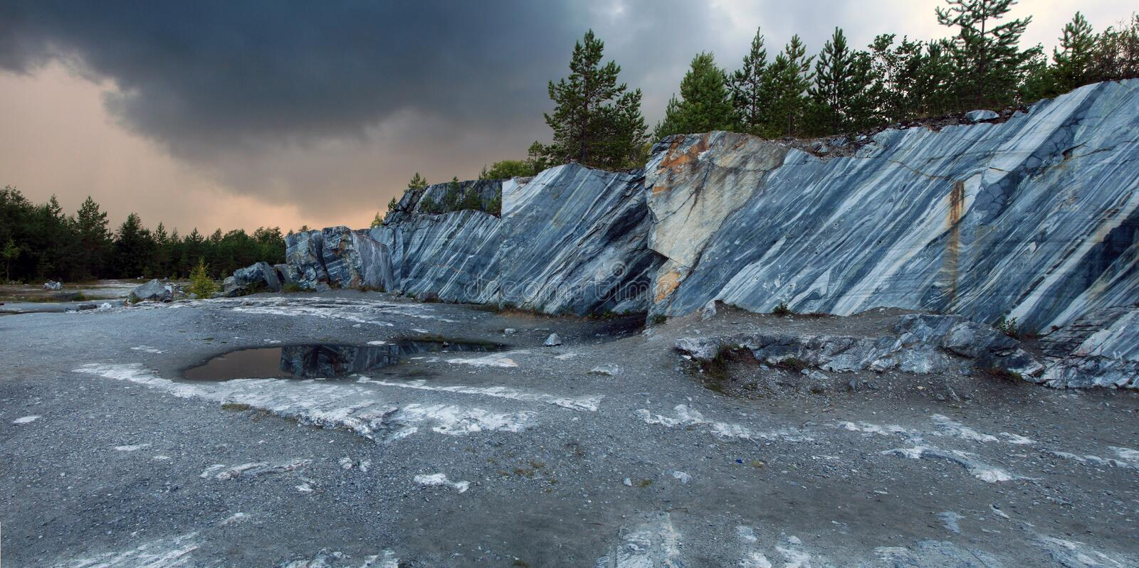 Abandoned marble quarry. On a cloudy day royalty free stock photo
