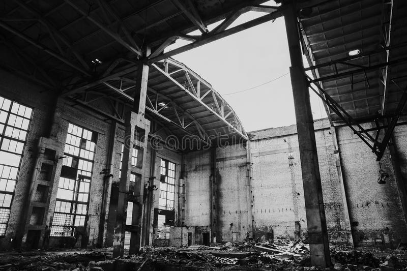 Abandoned metallurgical factory interior, ruined building. Black and white dramatic photo stock photo