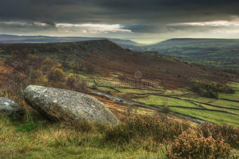 Abandoned millstones on Curbar Edge in Peak District stock photo