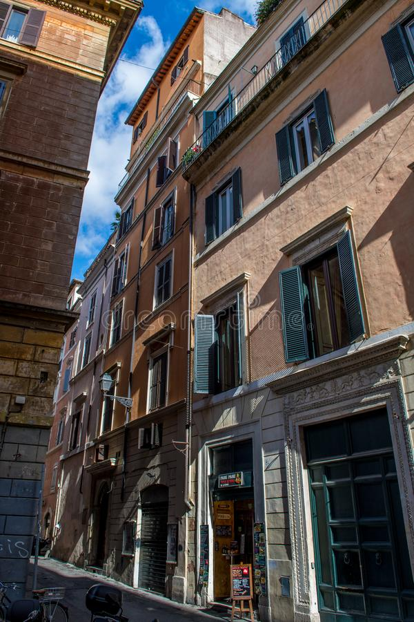 Abandoned Narrow Street with Shop in Rome in Italy royalty free stock photo