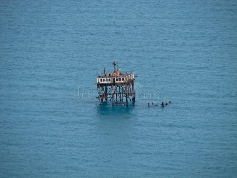 Abandoned oceanographic platform in the Blue Bay in Crimea stock image