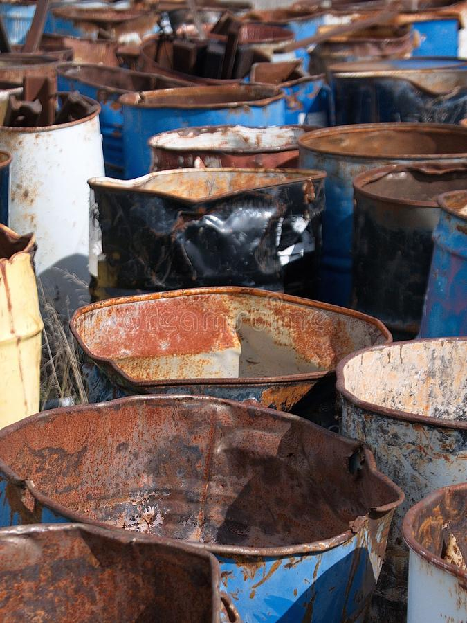 Abandoned oil drums. Old, empty and discarded oil drums left to rust in a rural field stock image