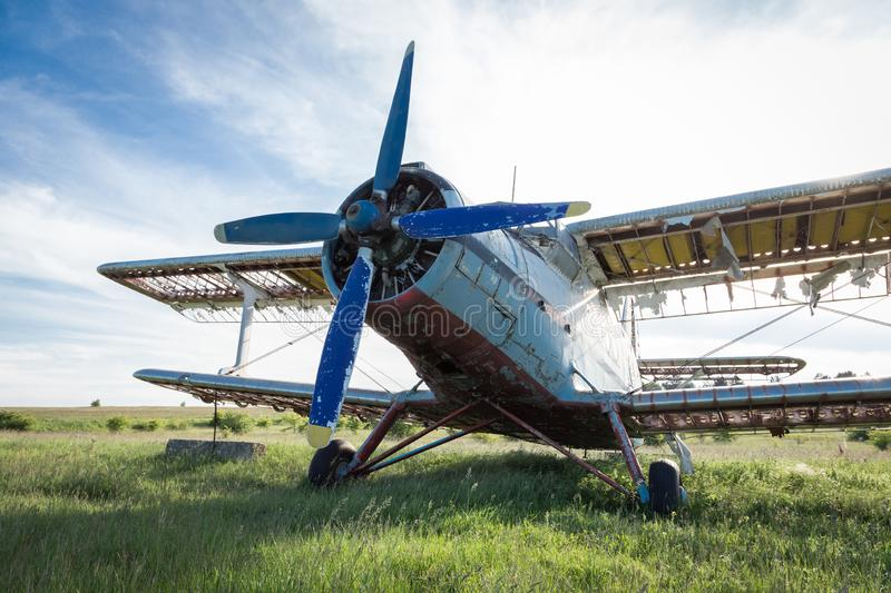 Abandoned old airplane on the field stock photo