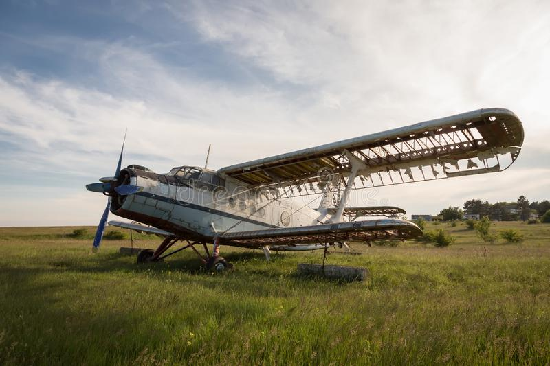Abandoned old airplane on the field royalty free stock photo