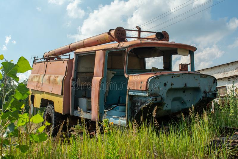 Abandoned old fire station truck during summer in the lost forgotten village royalty free stock photos