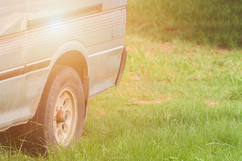 Abandoned old green van in the grass field. royalty free stock image