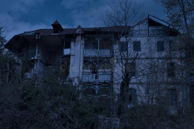 Abandoned old haunted house with dark horror atmosphere in the moonlight.  stock image