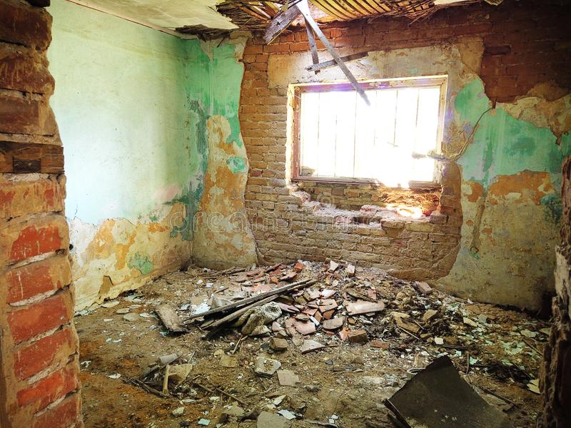 Abandoned old house interior with collapsed walls and shriveled.  stock photos