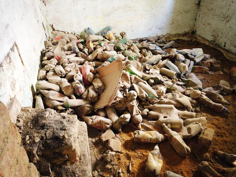 Abandoned old house interior full of empty plastic bottles.  stock photos