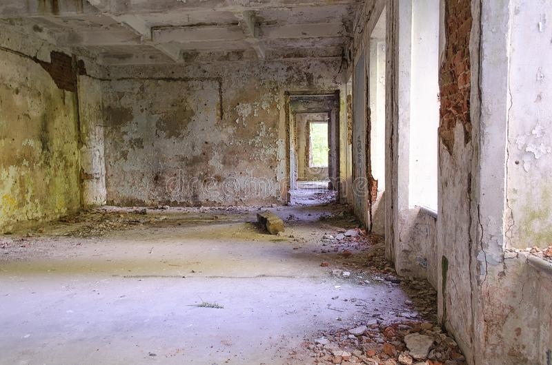 Abandoned old house with light penetrating through the windows royalty free stock images