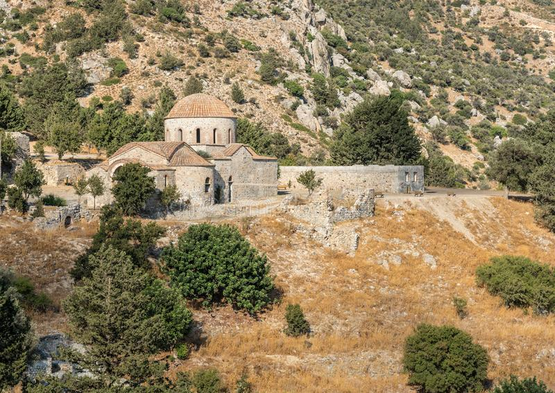 Abandoned old orthodox Christian church and olive tree royalty free stock image