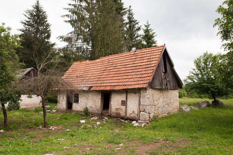 Abandoned old rural house with red rood. Village house. Orange, red roof tiles royalty free stock images