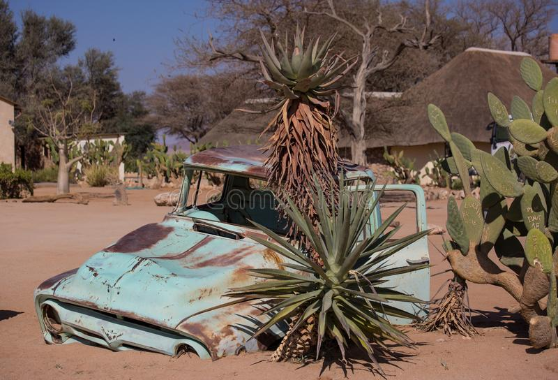 Abandoned old rusty wrecked historic car near a service station at Solitaire in Namibia desert ear the Namib-Naukluft royalty free stock image
