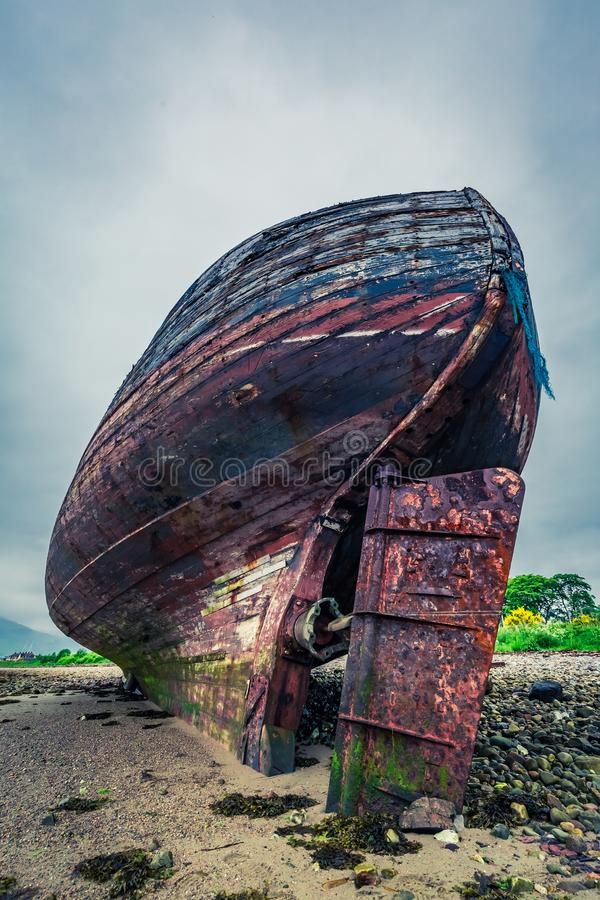 Abandoned old shipwreck on shore in Fort William. Scotland stock images