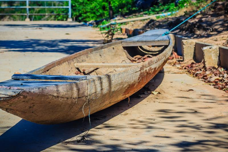 Abandoned old wooden boat on the shore. Shipwrecked wooden fishing boat on the land. royalty free stock images
