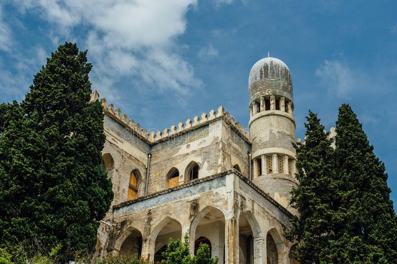 Abandoned and overgrown mansion in oriental style. Concept of Tale 1001 Arabian Nights. Villa Dream, Crimea.  stock photo