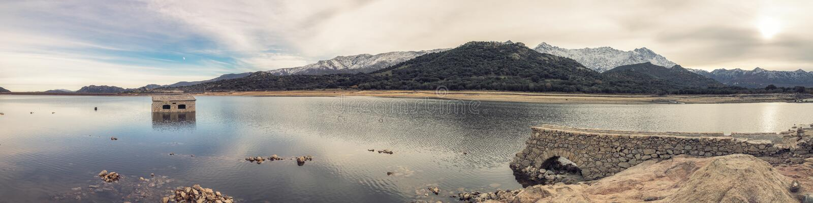 Abandoned and partially submerged stone building in lake in Corsica royalty free stock images