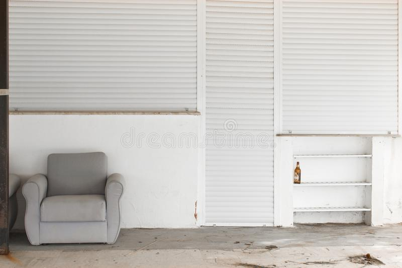 Abandoned place with a free couch. Very high detailed photo of an abandoned place with a free couch royalty free stock photography