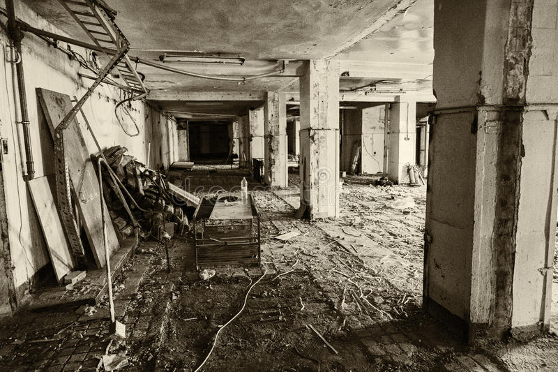 Abandoned production premise. Inside an abandoned deserted cluttered industrial building stock photo