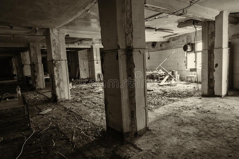 Abandoned production premise. Inside an abandoned deserted cluttered industrial building stock images