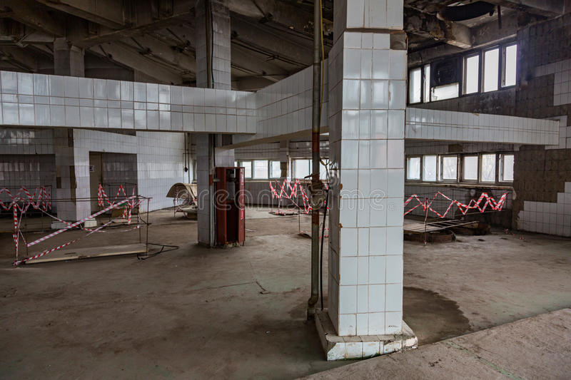 Abandoned production premise. Inside an abandoned deserted cluttered industrial building royalty free stock photography