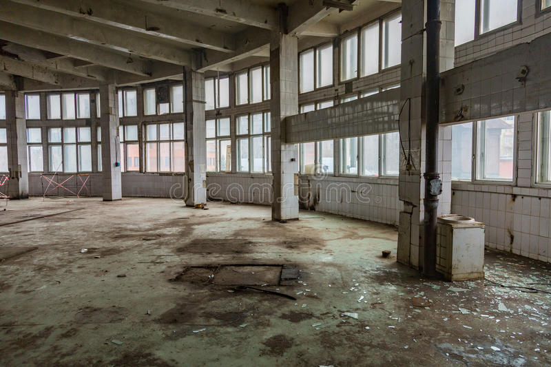 Abandoned production premise. Inside an abandoned deserted cluttered industrial building royalty free stock image