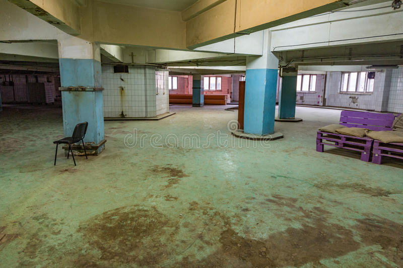 Abandoned production premise. Inside an abandoned deserted cluttered industrial building royalty free stock photo