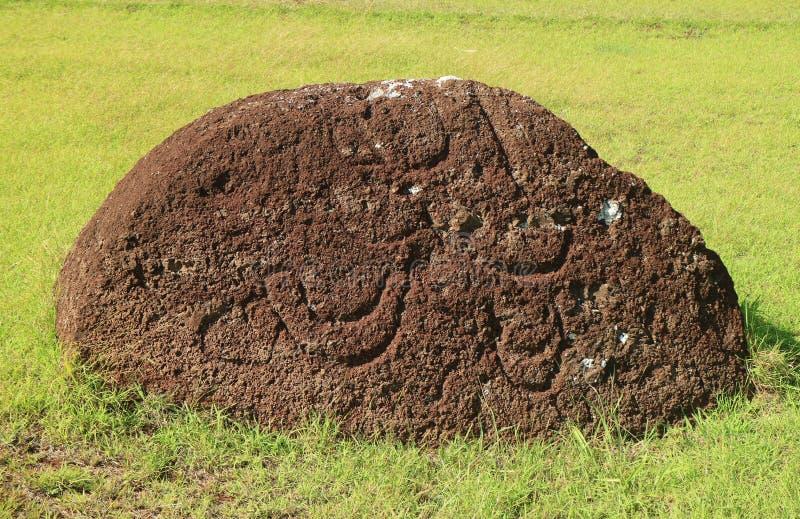 Abandoned Pukao or Moai Statue`s Topknot with the Petroglyph on Red Scoria Stone at Puna Pau Volcano, Easter Island, Chile. Abandoned Pukao or Moai Statue`s stock photo