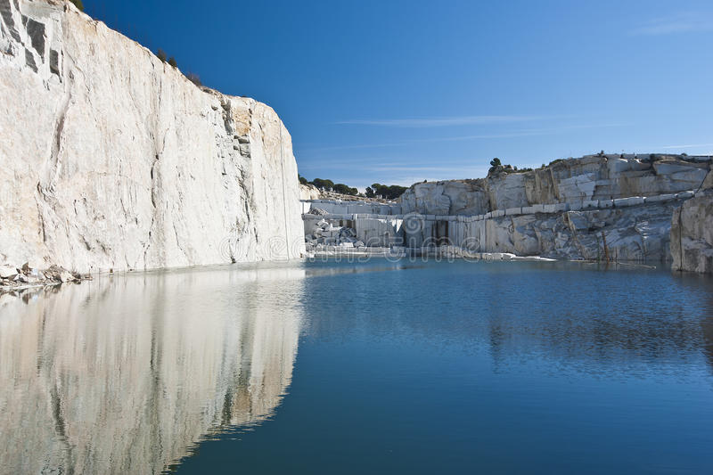Abandoned quarry. Abandoned granite quarry flooded by water royalty free stock images