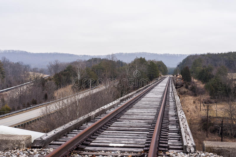 Abandoned Railroad - Track View on Cloudy AfternoonBridge. A view of an abandoned railroad atop a bridge in southern Ohio on a cloudy winter afternoon stock photography