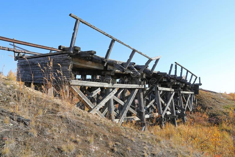 Abandoned railway bridge on a Sunny autumn day in the North of S. The old bridge was built by prisoners of Stalin`s prison camps Stalin 501-th construction of royalty free stock images