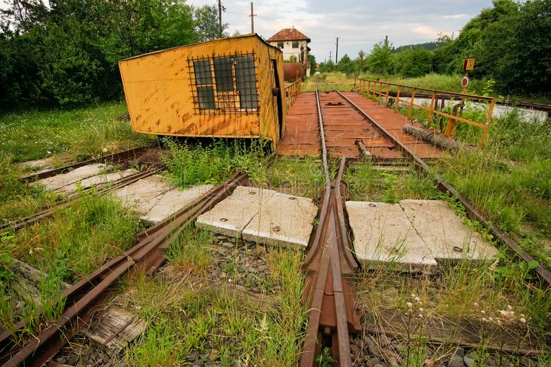 Abandoned railway rotating platform. Left to decay and rust with green vegetation stock photo