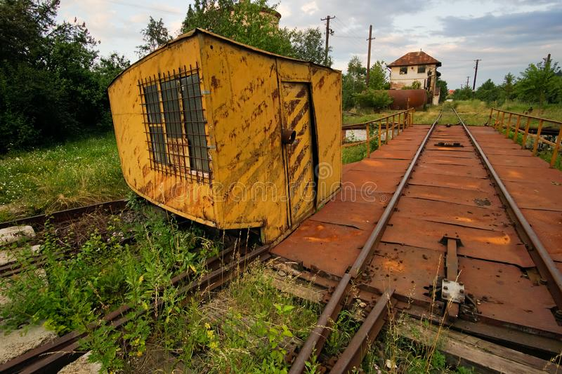 Abandoned railway rotating platform. Left to decay and rust with green vegetation stock images
