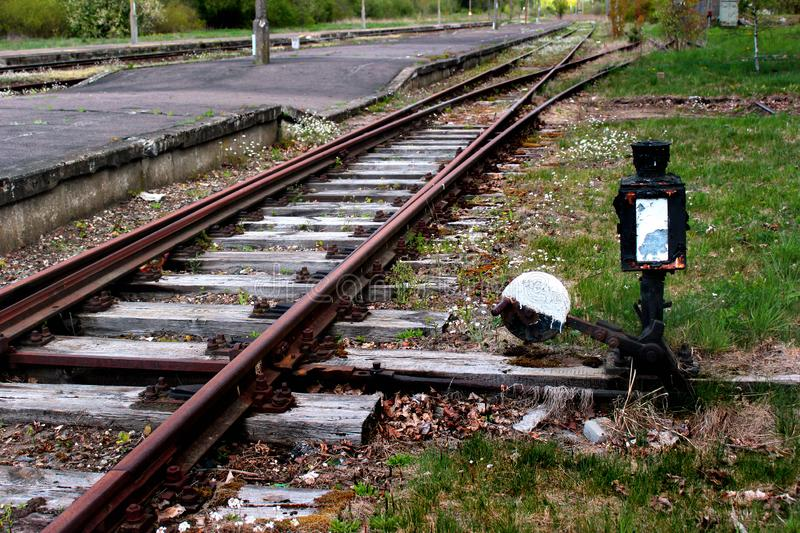 Abandoned railway station. Rusty rails and old switch.  stock photos