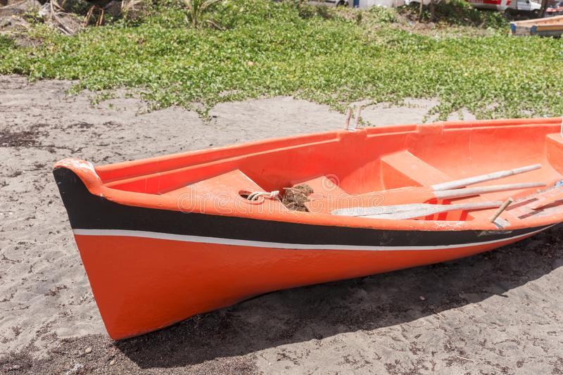Abandoned red wooden boat at the coast of the island Martinique. In the Caribbean royalty free stock image