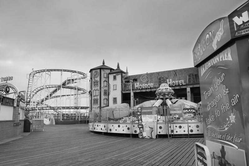 Abandoned Rides on Brighton Pier black white. Closed Horror hotel, rollercoaster ride on Brighton Pier - converted to black and white for more drama - Brighton royalty free stock photos