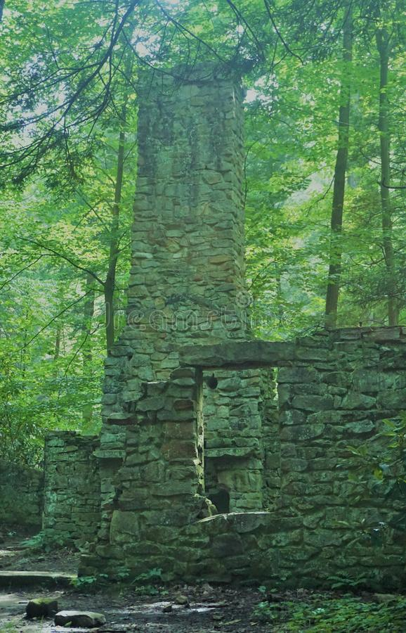 Abandoned rock house inside the forest royalty free stock image