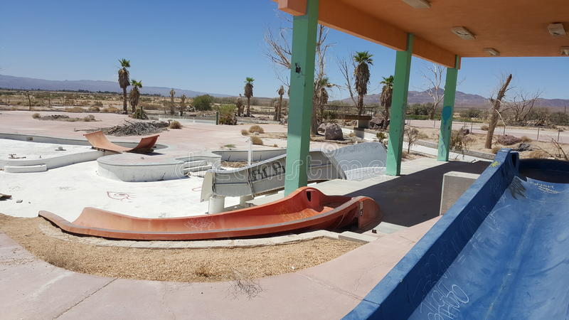 Abandoned rockahoola water park children's pool and slides royalty free stock photography