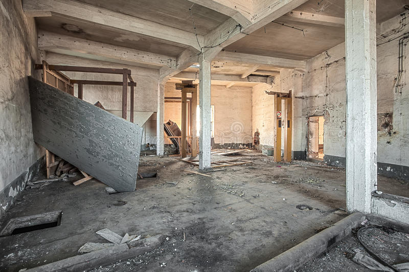 Abandoned room of an old factory. Destroyed room in an abandoned factory royalty free stock photography