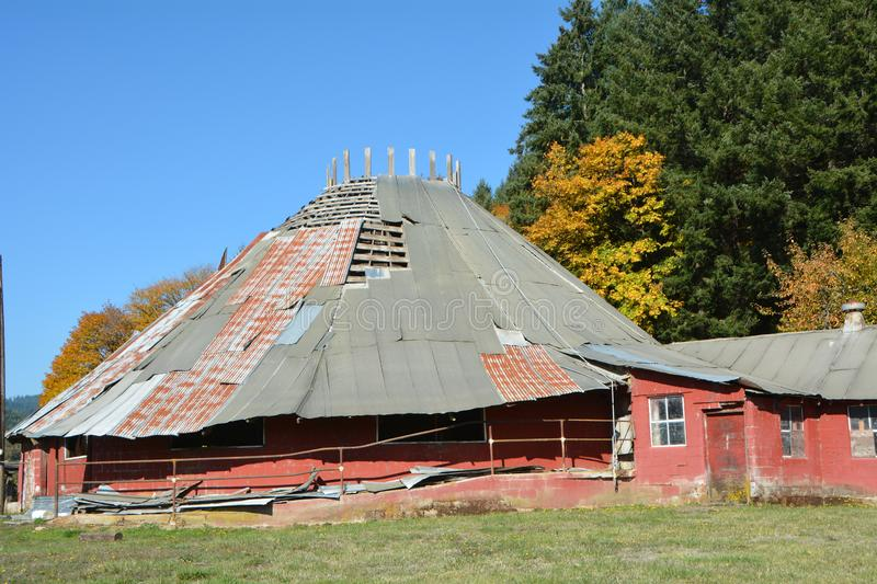 Abandoned round barn near Triangle Lake, Oregon. This is an abandoned round barn near Triangle Lake, Oregon that is slowly being refurbished for use stock photos