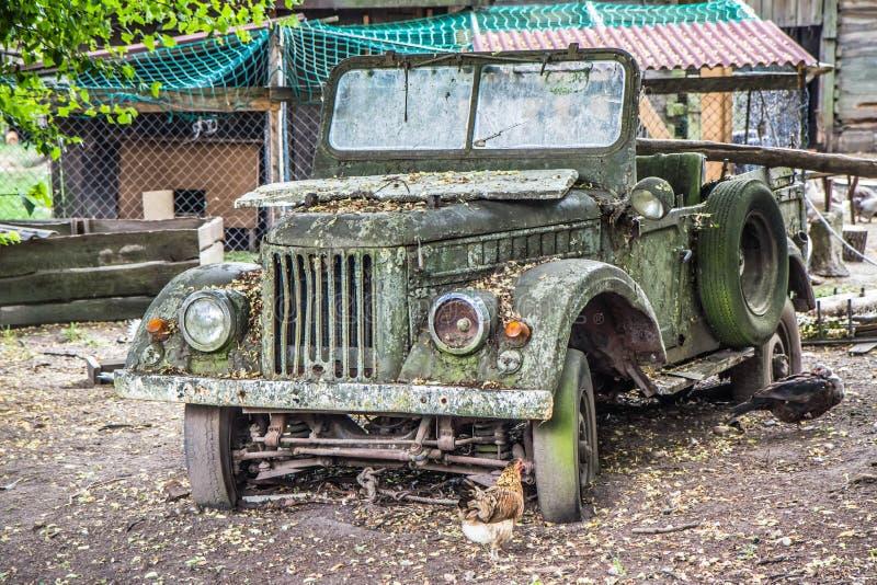 Abandoned ruined car stock image
