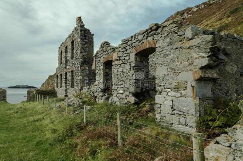 The abandoned ruined factory buildings of the Llanlleiana old porcelain works at Llanbadrig royalty free stock photo