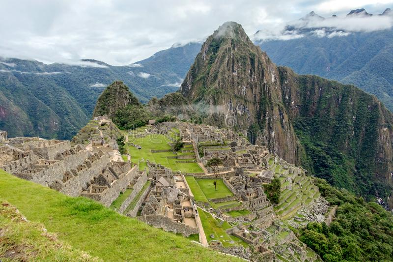 Abandoned ruins of Machu Picchu Incan citadel, the maze of terraces and walls rising out of the thick undergrowth, Peru. Machu Picchu Incan citadel, abandoned royalty free stock photos