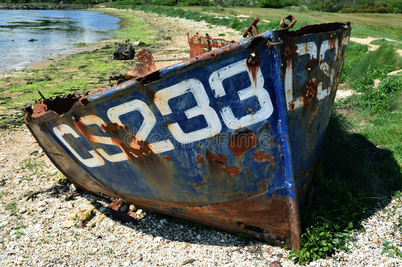 Abandoned rusty blue boat. Abandon trusty boat on the Isle of Wight stock photo