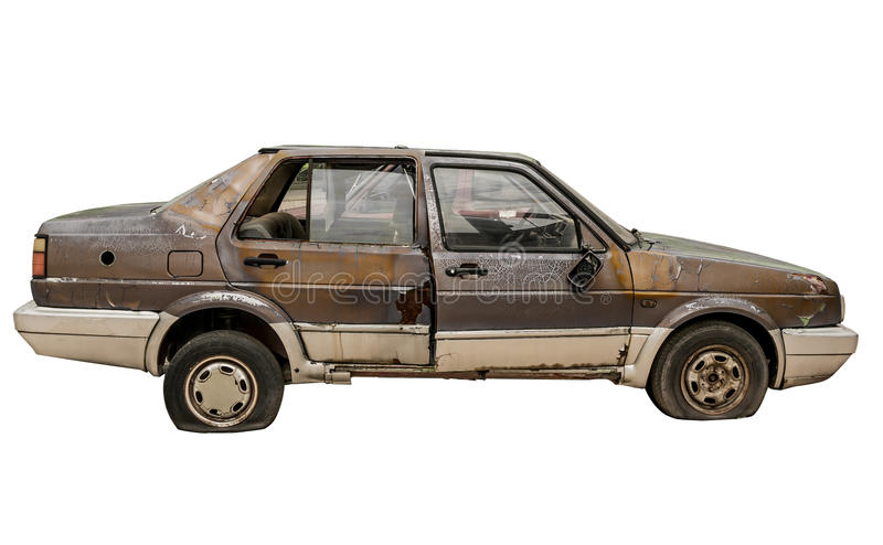 Abandoned rusty car isolated royalty free stock photography
