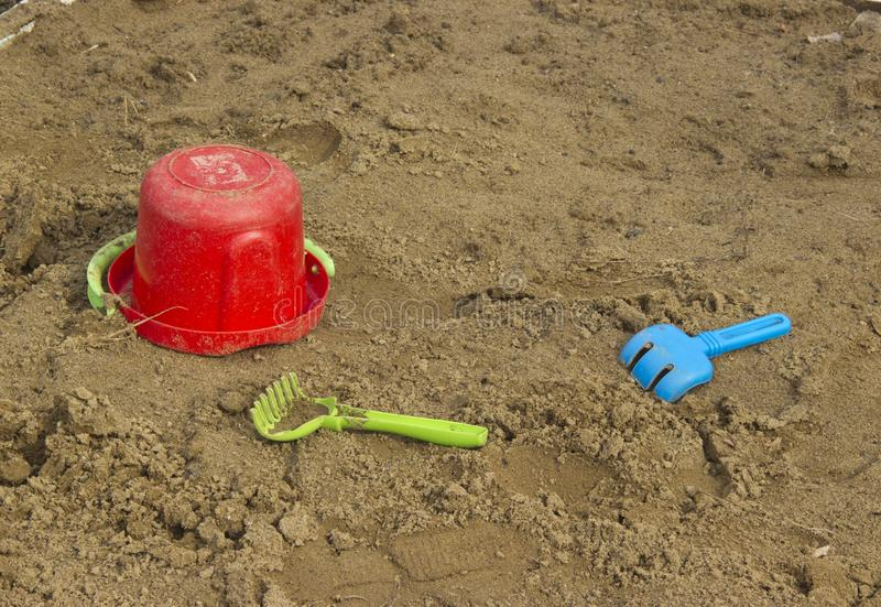 Children`s toys. Abandoned in the sandbox children`s toys stock photography