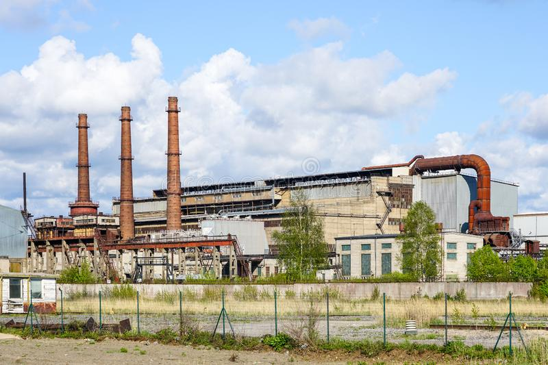 Abandoned scrap metal recycling metallurgical plant for electric steel melting royalty free stock image
