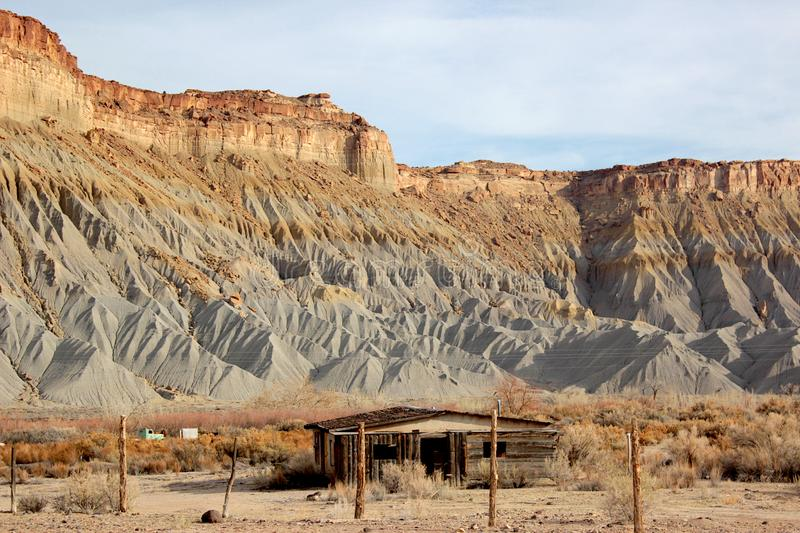 Abandoned Shack in Utah Desert with Fence and Cliffs royalty free stock photos